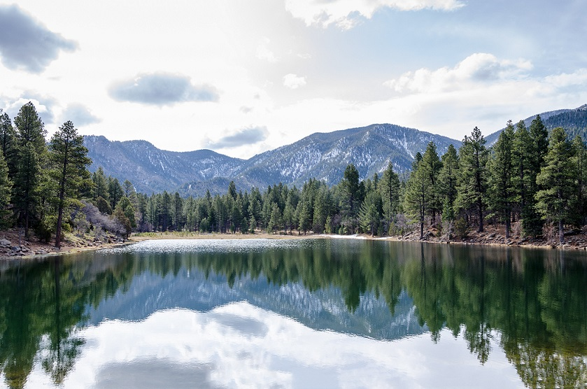 a lake under mountain peaks in dixie national forest